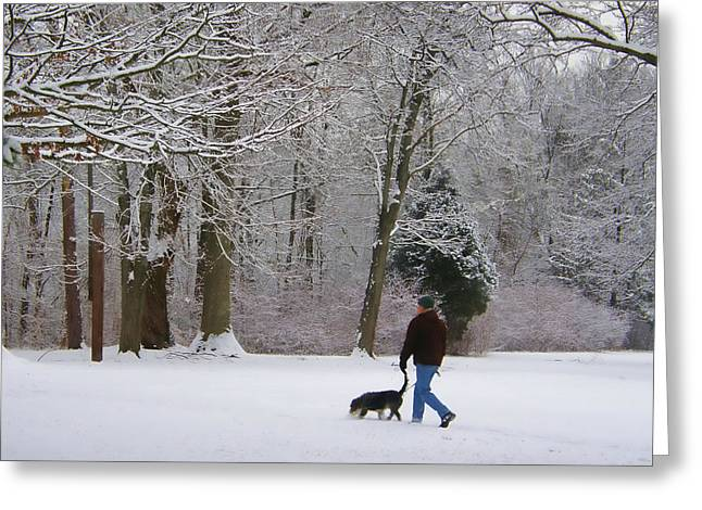 Dog Walker In Snow Greeting Card by James Yellen