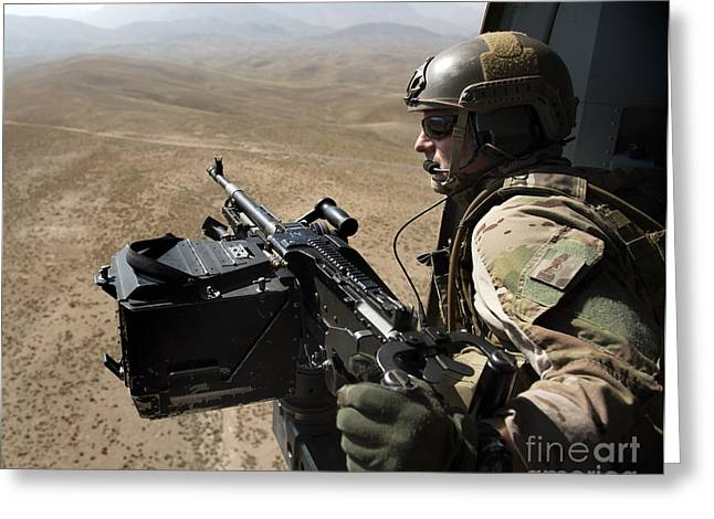 Door Gunner Scans The Terrain Greeting Card by Stocktrek Images