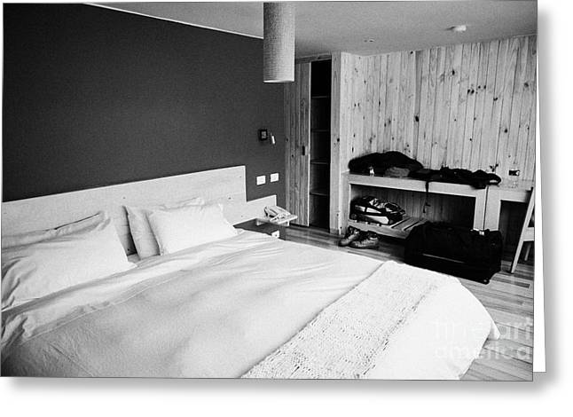 double bed in a new boutique hotel with luggage in the room in Punta Arenas Chile Greeting Card by Joe Fox