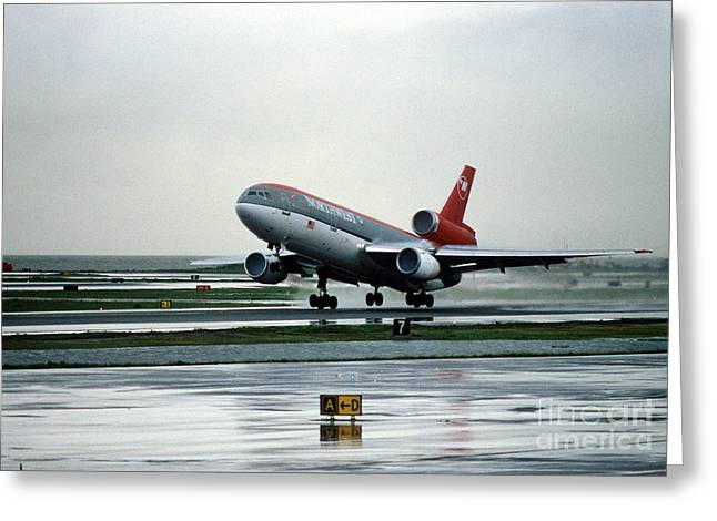 Douglas Dc-10-40 Taking Off In The Rain Greeting Card