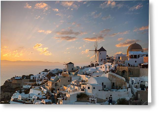 Dramatic Sunset Over The Windmills Of Oia Village In Santorini Greeting Card by Gurgen Bakhshetsyan