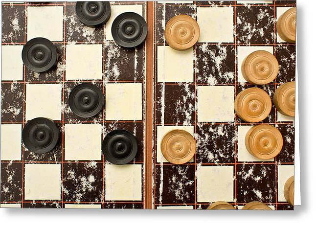 Draughts Pieces Greeting Card by Tom Gowanlock