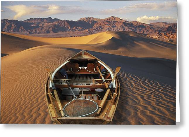 Drift Boat Resting On Sand Dunes In Greeting Card by Ron Sanford