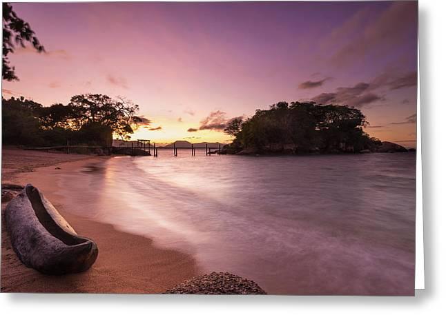 Dugout Canoe On Small Beach On Mumbo Greeting Card by Ian Cumming