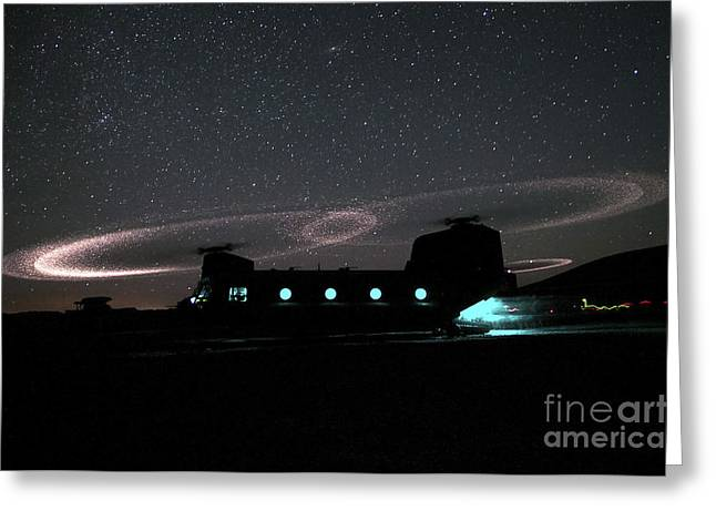 Dust Lights Up The Rotors Of A Ch-47 Greeting Card by Stocktrek Images