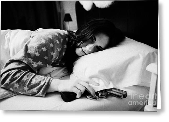 Early Twenties Woman Waking With Hand On Handgun Under Pillow At Night In Bed In A Bedroom Greeting Card by Joe Fox