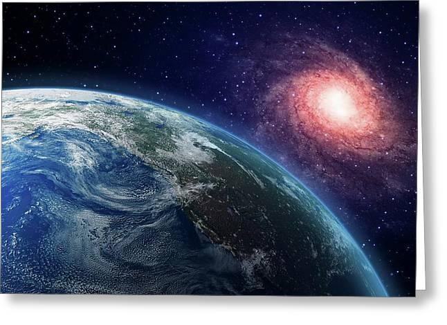 Earth And Galaxy Greeting Card by Andrzej Wojcicki