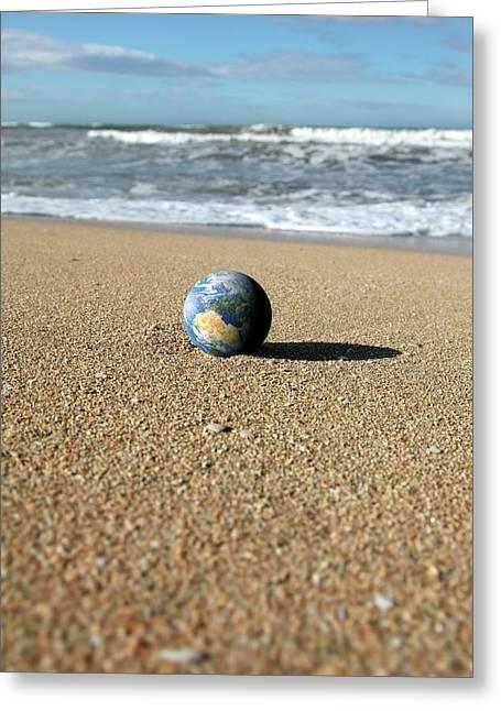 Earth On A Beach Greeting Card by Detlev Van Ravenswaay