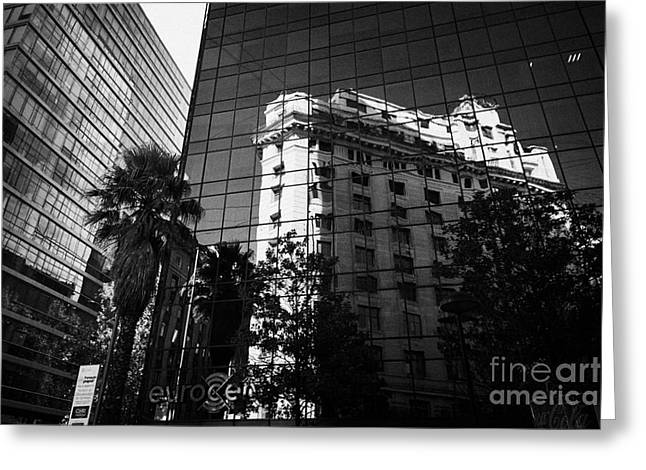 edificio ariztia building reflected in modern bank buildings in the financial district of Santiago Chile Greeting Card by Joe Fox
