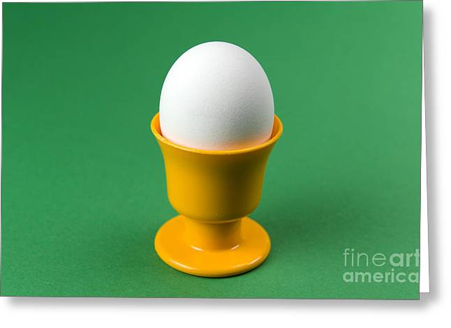 Egg In Cup At Green Background Greeting Card by Kennerth and Birgitta Kullman