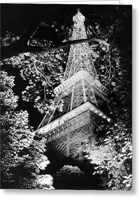 Eiffel Tower At Night Greeting Card by Underwood Archives