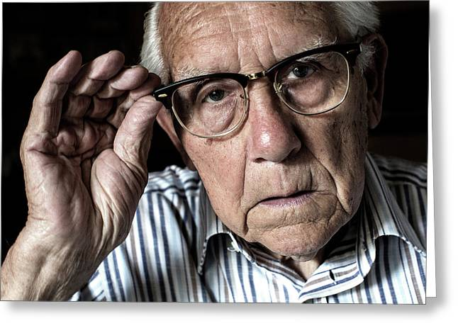 Elderly Man Adjusting His Glasses Greeting Card