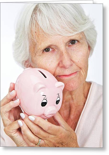 Elderly Woman With A Piggy Bank Greeting Card by Lea Paterson