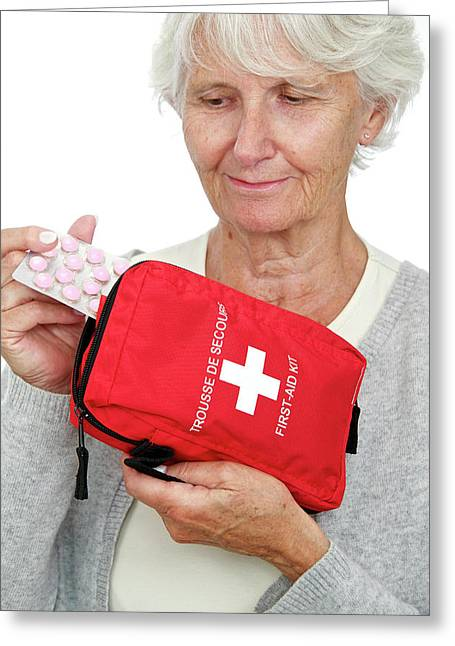 Elderly Woman With First Aid Kit Greeting Card