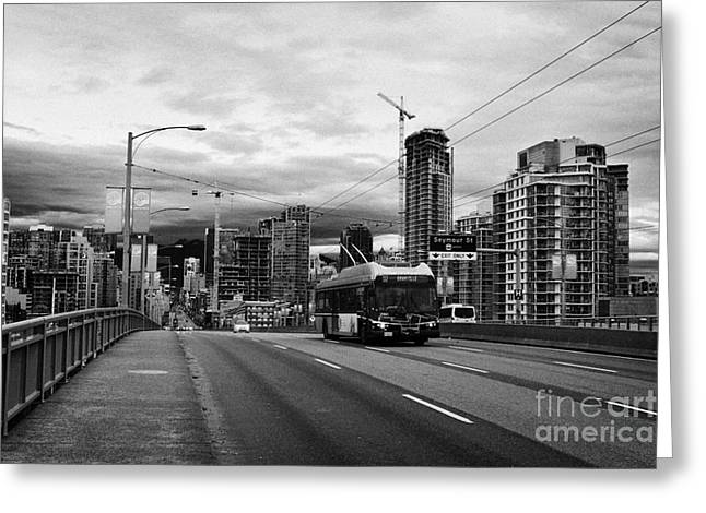 electric bus on granville street bridge over false creek Vancouver BC Canada Greeting Card by Joe Fox