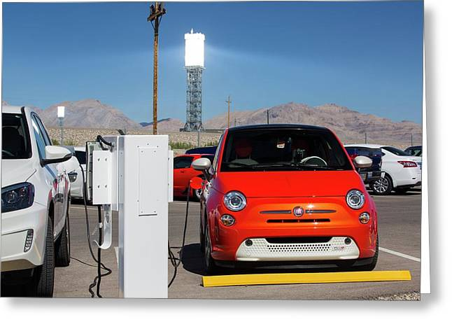 Electric Cars Being Recharged Greeting Card by Ashley Cooper