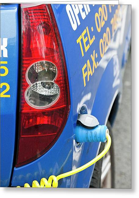 Electric Vehicle At A Charging Station Greeting Card
