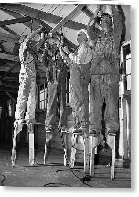 Electricians On Stilts Greeting Card by Underwood Archives