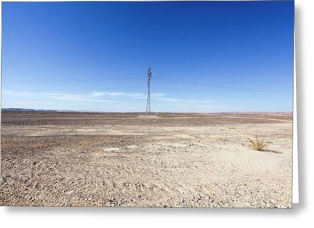 Electricity Pylon In Desert Greeting Card