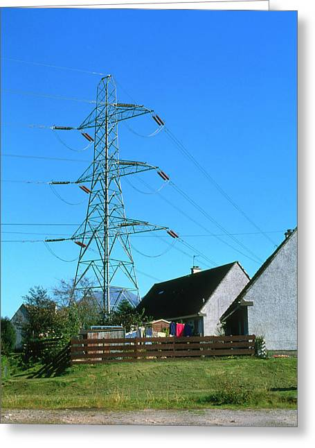 Electricity Pylons & Cables Over Village Greeting Card
