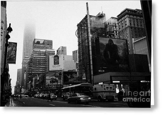 empire state building shrouded in mist from west 34th Street and 7th Avenue new york city usa Greeting Card by Joe Fox