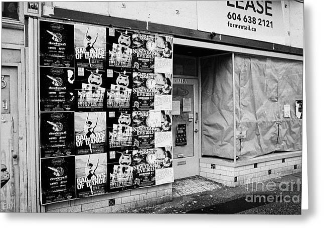 empty downtown store for lease covered in posters Vancouver BC Canada Greeting Card by Joe Fox
