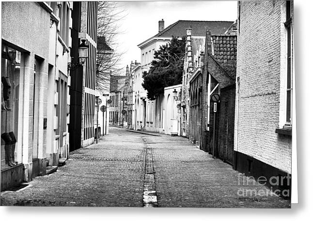 Empty Street In Bruges Greeting Card by John Rizzuto