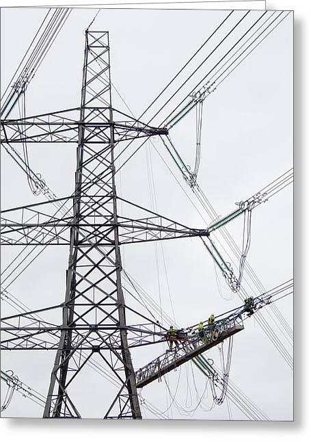 Engineers Working On Power Lines Greeting Card by Ashley Cooper