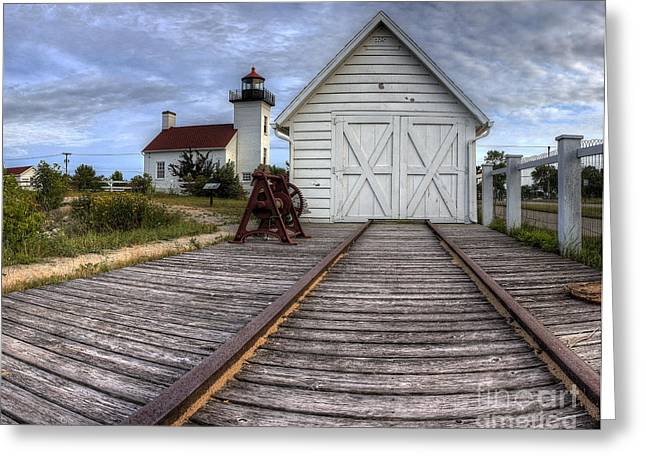 Escanaba Lighthouse And Boat House Greeting Card