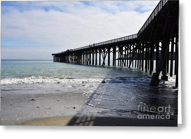 Greeting Card featuring the photograph Evening Pier Shadows Are Lost In The Surf by Debby Pueschel