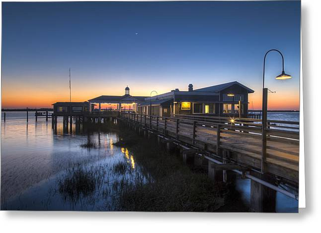 Evening Sky At The Dock Greeting Card by Debra and Dave Vanderlaan