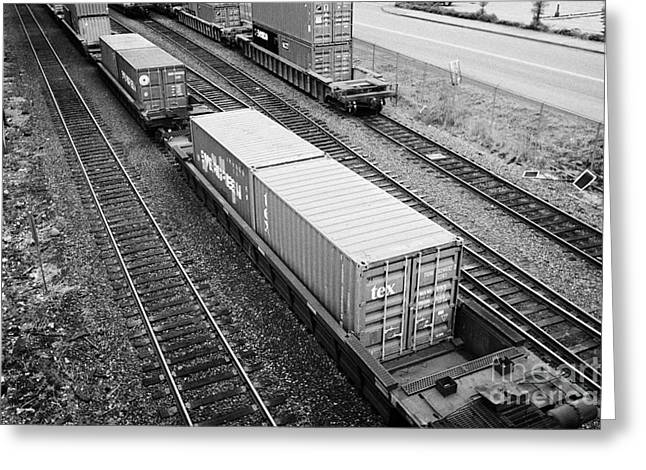 evergreen and tex freight shipping containers on rail cars freight train goods tracks Vancouver BC C Greeting Card