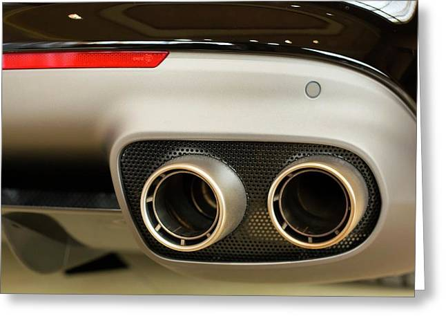 Exhaust Pipes Of A Ferrari California Greeting Card by Jim West