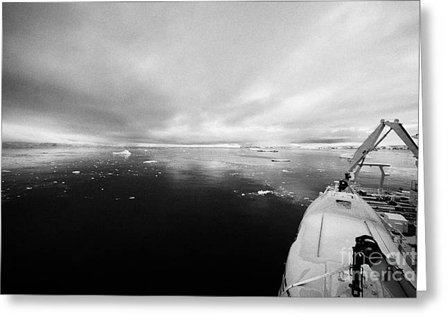 expedition ship with lifeboat covered in snow moored in Fournier Bay on Anvers Island Antarctica Greeting Card by Joe Fox