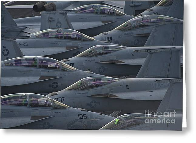 Fa18 Super Hornets Sit On The Flight Deck Of The Aircraft Carrier Uss Enterprise  Greeting Card by Paul Fearn