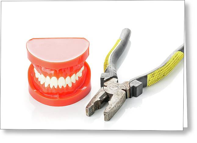 False Teeth And A Pair Of Pliers Greeting Card