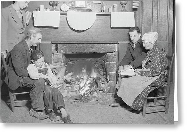 Family By Fireplace At Their Home Greeting Card