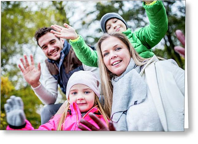 Family Waving Hands Greeting Card by Science Photo Library