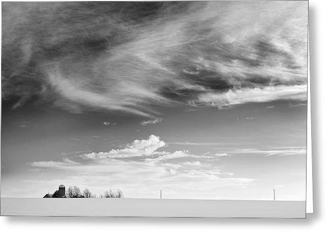 Farm In The Distance In A Snowy Field Greeting Card by Patrick LaRoque