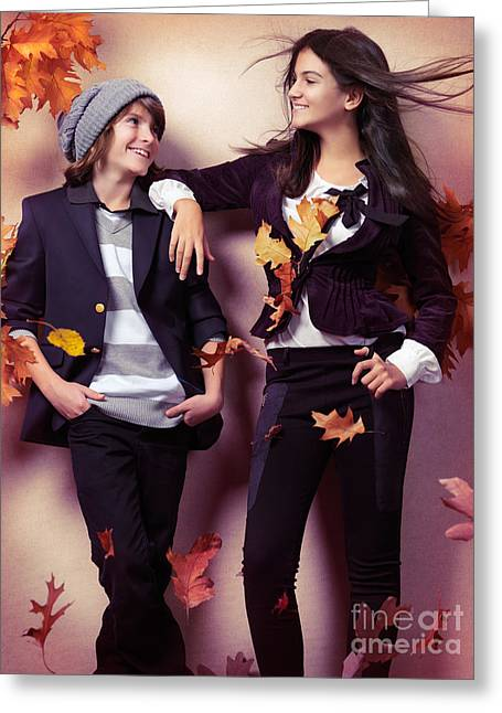 Fashionably Dressed Boy And Teenage Girl Under Falling Autumn Le Greeting Card by Oleksiy Maksymenko