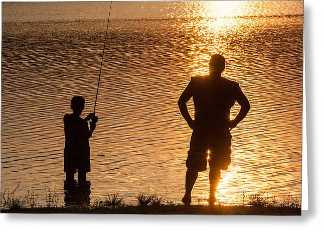 Father And Son Fishing At Sunset Photograph By Aaron Baker