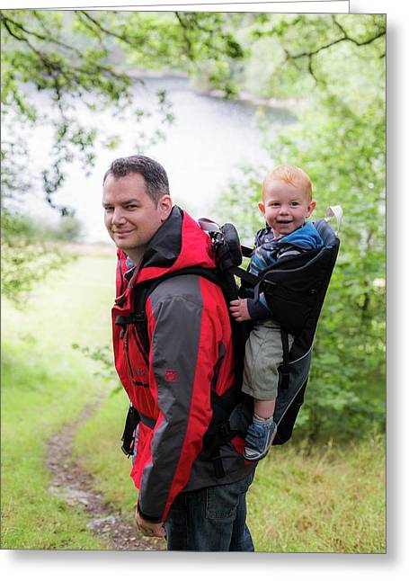 Father Carrying Son In Back Carrier Greeting Card