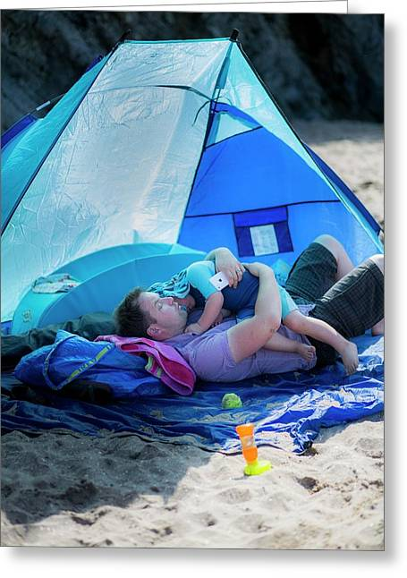 Father Holding Son In A Tent On Beach Greeting Card by Samuel Ashfield