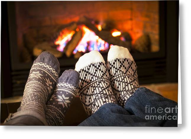 Feet Warming By Fireplace Greeting Card