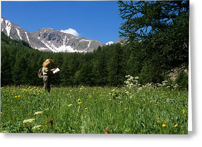 Female Hiker Holding A Map Greeting Card by Panoramic Images