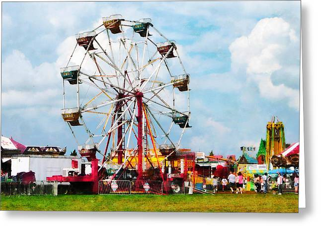 Ferris Wheel Against Blue Sky Greeting Card by Susan Savad