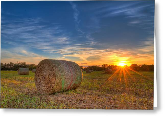 A Hay Bale Sunset Greeting Card by Tim Stanley