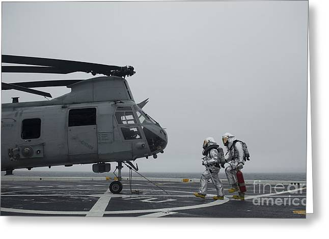 Firefighters Approach A Ch-46 Sea Greeting Card by Stocktrek Images