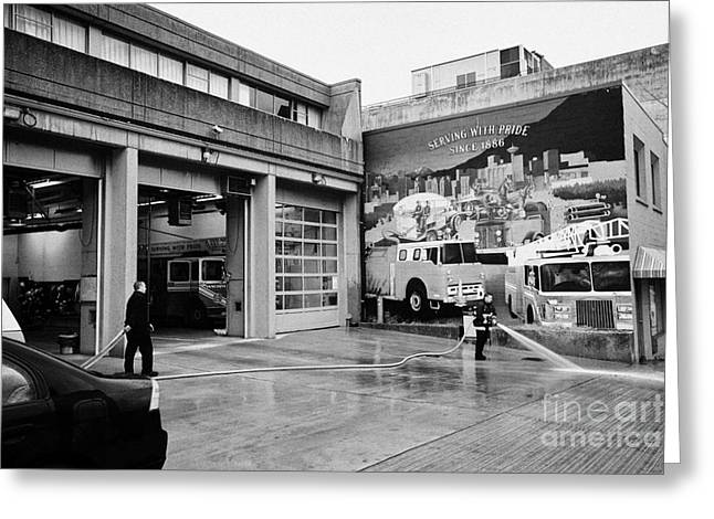 firemen hosing down Vancouver fire rescue services hall 2 in downtown eastside  BC Canada Greeting Card