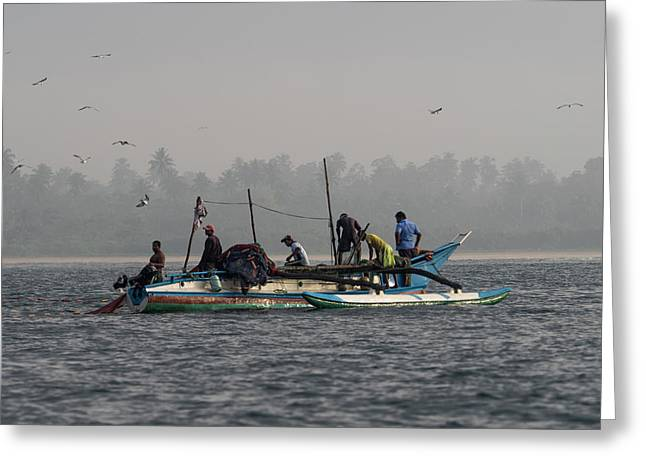 Fisherman Hauling Nets Aboard In Waters Greeting Card by Panoramic Images